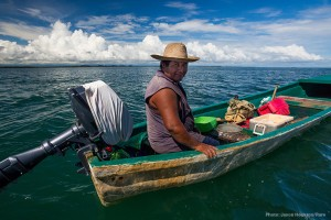 A fisherman handlines from his small panga off the coast of Punta Gorda, Belize. A full cooler of small snapper might be worth $100 for his day of work. Photo © Jason Houston/Rare