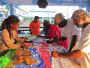 Community members construct a 3D model of the surrounding villages and the Bay of Grenville, highlighting existing natural and cultural resources. © TNC