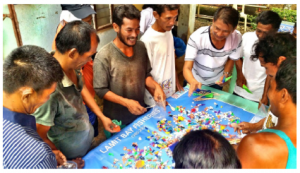 "Participants in Palau play ""What's the Catch"" to learn about fisheries management. Photo © Rare"