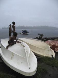 Island fishing boats and children in the area of Manus Province, North Bismarck Sea, Papua New Guinea. © Louise Goggin