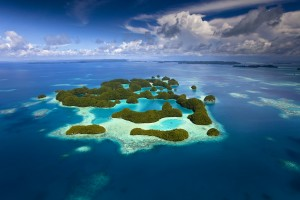 "Aerial view of Palau known as ""70 Mile Islands"" as well as the rich coral reef surrounding them. © Ian Shive"